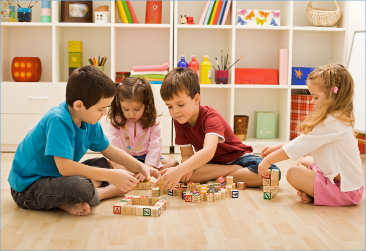 A Group Of Children Playing Blocks