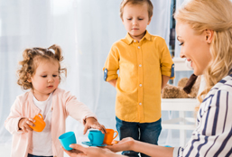 Mother And Kids Playing With Teacups