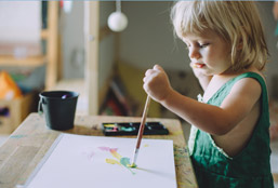 Girl Painting With A Brush On Paper