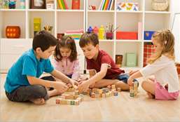 Group Of Kids Playing With Blocks